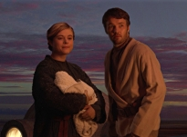 Aunt Beru (holding baby Luke) and uncle Owen Photo Credit - Star Wars Episode III: Revenge of the Sith