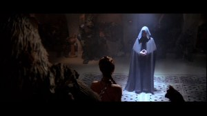 Luke stands before Jabba. Notice how similar he looks to Palpatine (black robe, hood pulled over his head). Photo Credit - Star Wars Episode VI: Return of the Jedi