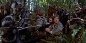 An Ewok hunting party surrounds Han, Luke, and Chewbacca Photo Credit - Star Wars Episode VI: Return of the Jedi