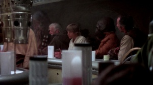 Chewbacca and Obi-Wan Kenobi chat at the Mos Eisley Cantina bar.  Photo Credit - Star Wars Episode IV: A New Hope