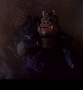 A Gamorrean attempts to free himself from Luke's stranglehold. Photo Credit - Star Wars Episode VI: Return of the Jedi